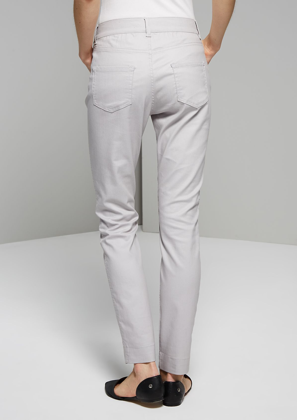 Feminine denim trousers with charming design features from s.Oliver