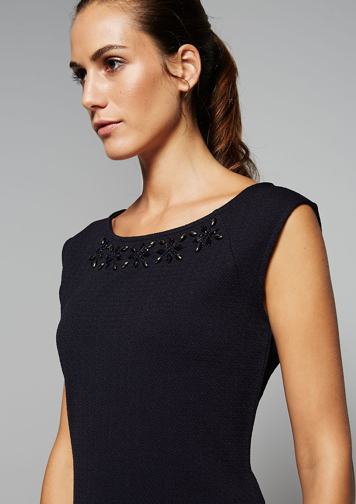 Sleeveless top with a glamorous rhinestone trim from s.Oliver