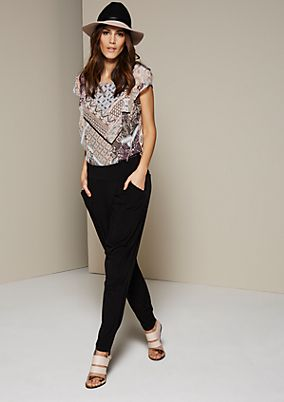 Extravagant jersey trousers with pretty details from s.Oliver