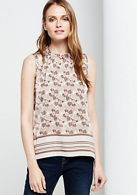 Elegant satin top with an exciting all-over print from s.Oliver