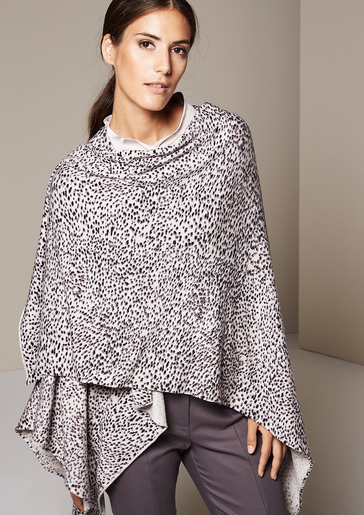 Glamorous knit poncho with a beautifully designed all-over print from s.Oliver