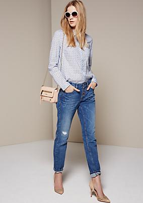Feminine Bluse mit dekorativem Allovermuster