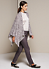 Glamouröser Strickponcho mit schön gestaltetem Alloverprint