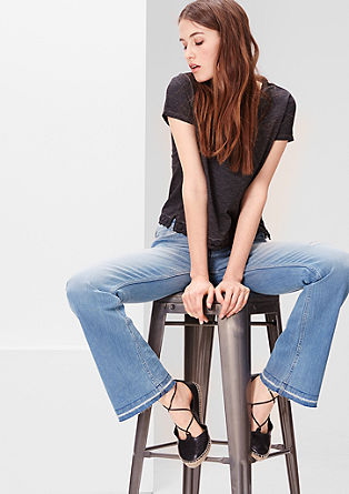 Bell Bottom: flared jeans with distressed details from s.Oliver