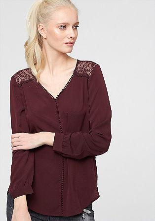 Bluse mit Spitze und Pompom-Saum