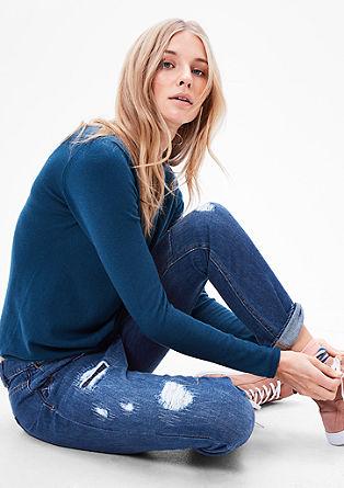 Bowleg: jeans hlače z raztrganinami in popravljenimi mesti