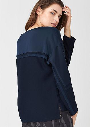 Boxy blouse van een materiaalmix