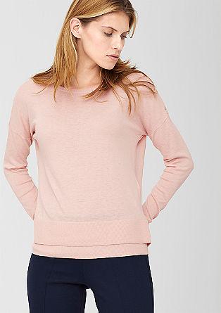 Fijne gebreide trui met een zoom in laagjeslook