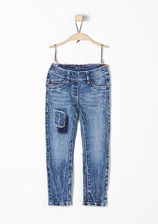 Hlačne pajkice: jeans hlače z našitkom