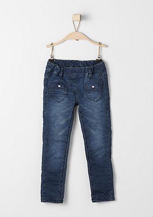 Hlačne pajkice: raztegljive jeans hlače s srčki