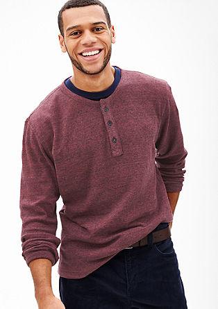 Lahek pulover z delom z gumbi