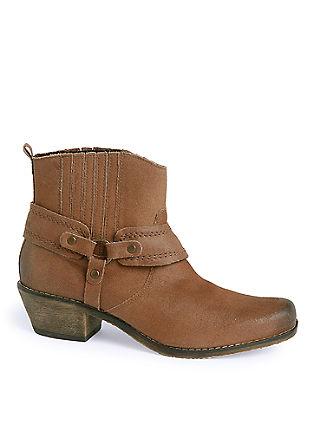 Leren booties in een cowboy look