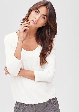 Majica ovitega videza in detajlom v slogu bluze