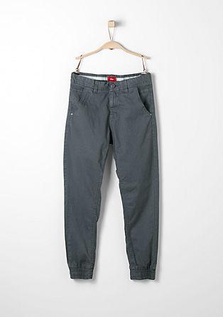 Ozke hlače iz blaga z okrasnim robom