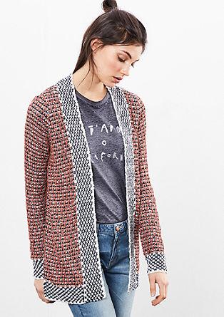 Pletený kabátek se švy se vzhledem přetočeným naruby