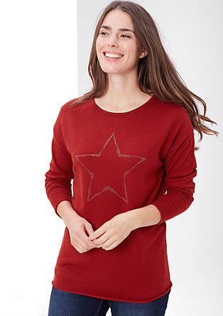 Pulover iz tanke pletenine s kovicami, ki oblikujejo zvezdo