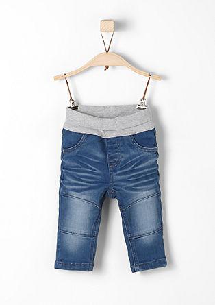 Raztegljive jeans hlače v ponošenem videzu