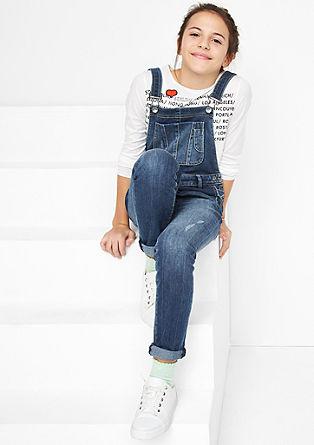Raztegljive jeans hlače z oprsnikom v obrabljenem videzu
