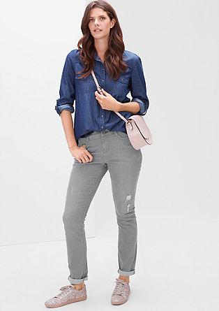 Regular: slim fit jeans met slijtageplekken