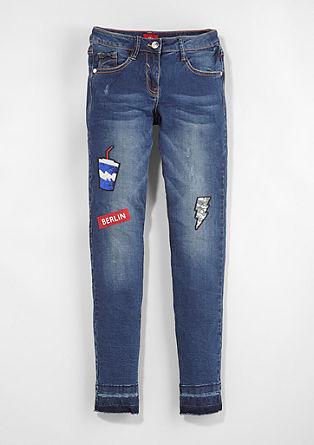 Skinny Suri: jeans hlače z našitki