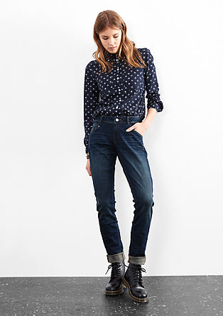 Slim: stretch jeans with a pink button from s.Oliver
