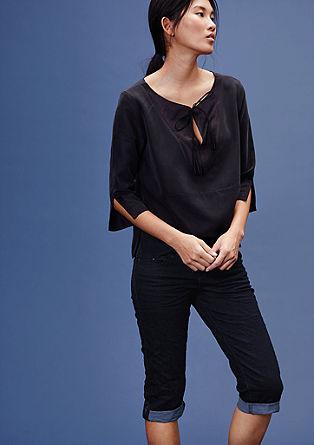 Slim: Used-Jeans im Capri-Stil
