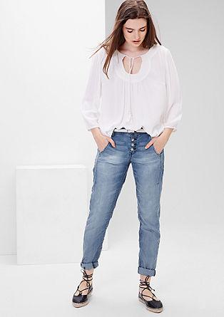 Smart chino: jeans met gevlochten riem