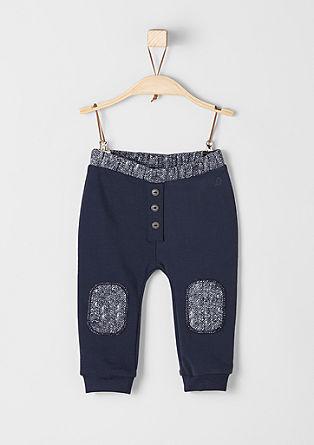 Športne hlače z gumbi in zaplatami