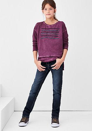 Suri: raztegljive jeans hlače s kontrastnimi šivi