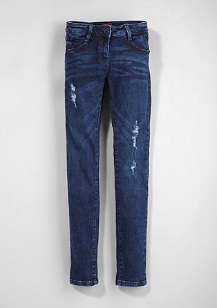 Suri Slim: elastische jeans met een used look