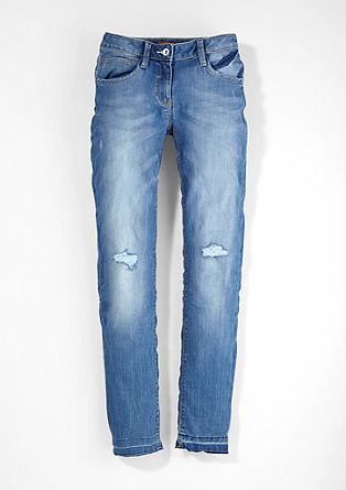 Suri slim: jeans met slijtageplekken