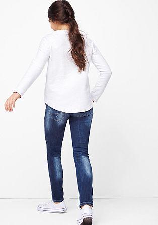 Suri Slim: raztegljive jeans hlače v obrabljenem videzu