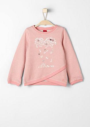 Svetlikajoč se pulover s srčki