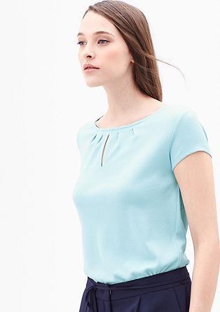 Vrouwelijk shirt met een piquéstructuur