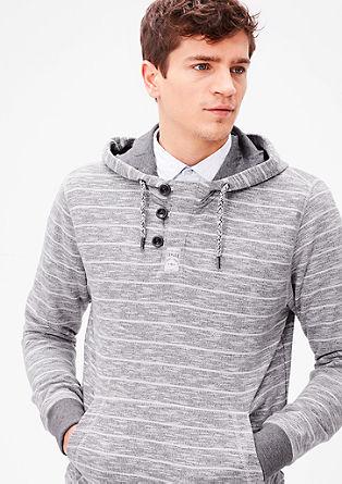 Vzorčast sweatshirt pulover s kapuco in gumbi
