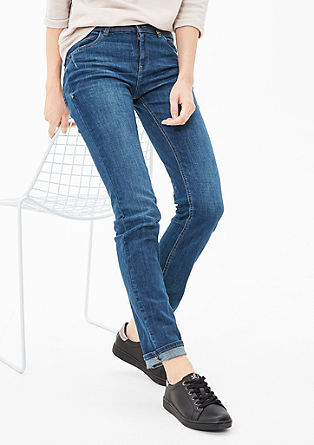Shape slim: jeans met details in used look