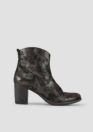 Kovinski škornji lesketajočega se videza