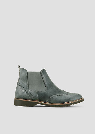 Chelsea boots met details in brogue style