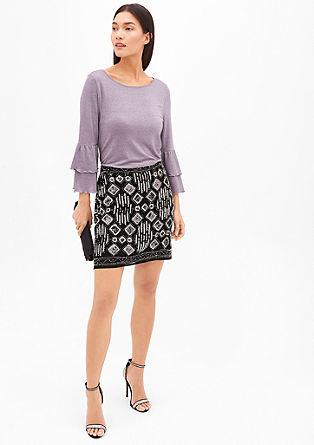 Krátká sukně spajetkami