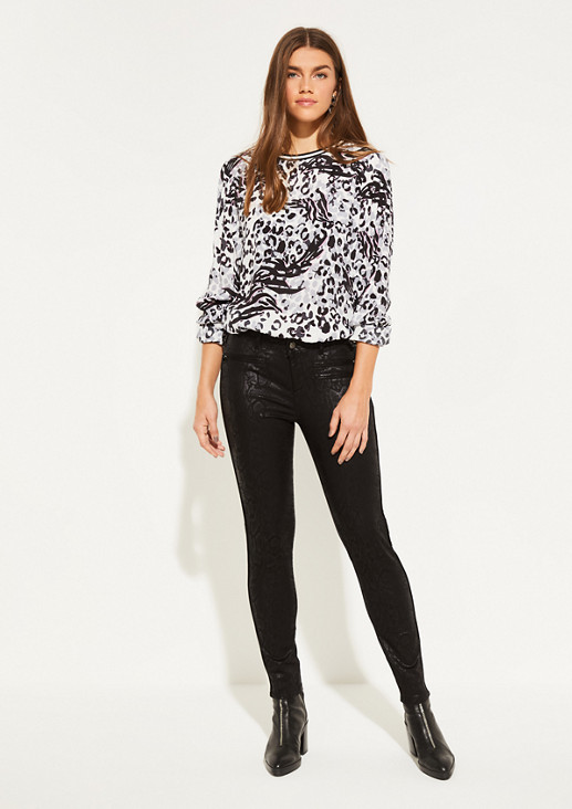 Trousers with a tone-in-tone snakeskin print from comma
