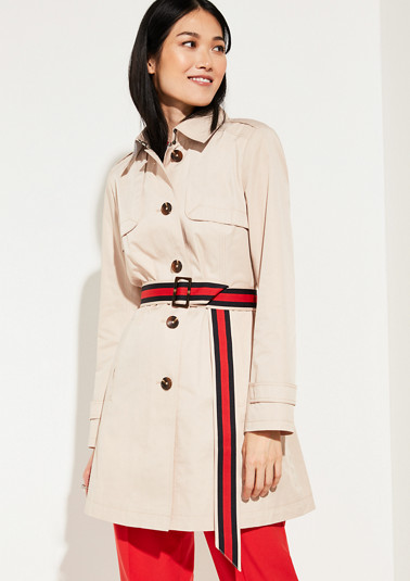 Coat with tape from comma