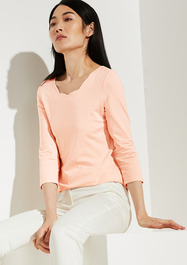 Top with a scalloped neckline from comma