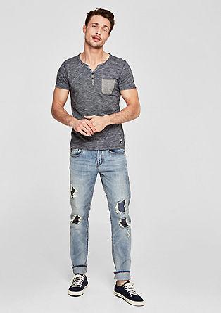 Close slim: jeans met slijtageplekken