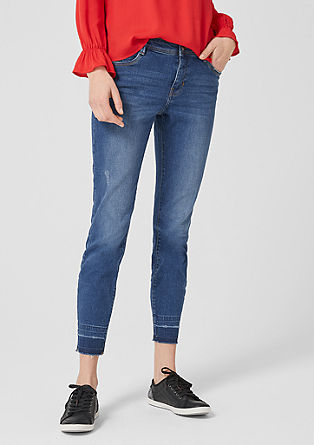 Shape ankle: jeans met details in used look