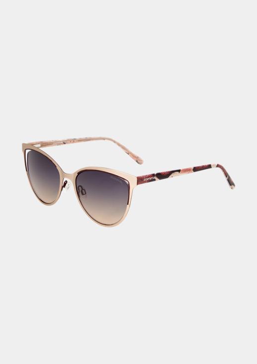 Extravagante Brille mit Python-Muster
