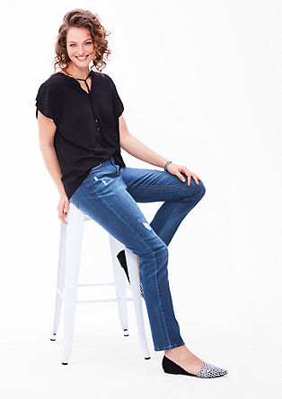 Regular: Straight leg jeans with distressed details from s.Oliver
