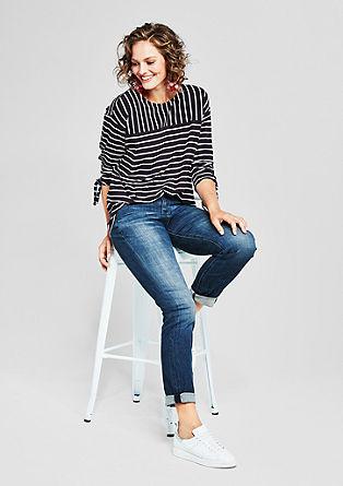Regular Slim: raztegljive jeans hlače z vezeno