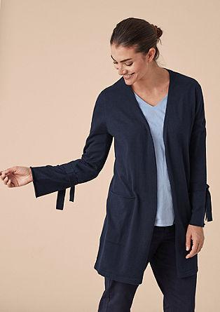 Pletený kabátek s detaily mašle