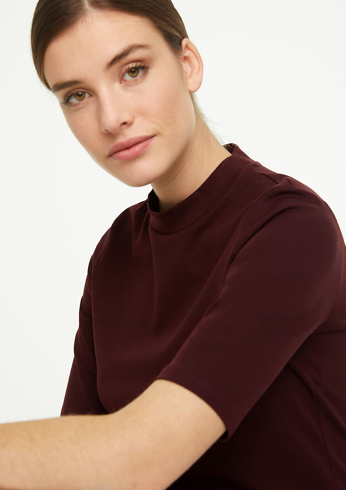 Jersey top with a stand-up collar from comma