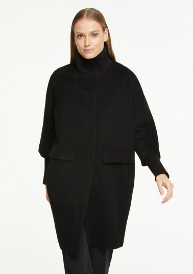 Cape coat with rib knit details from comma